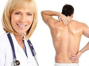 A doctor cures the back pain